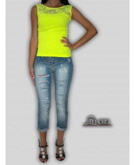 Jeans capri strappato